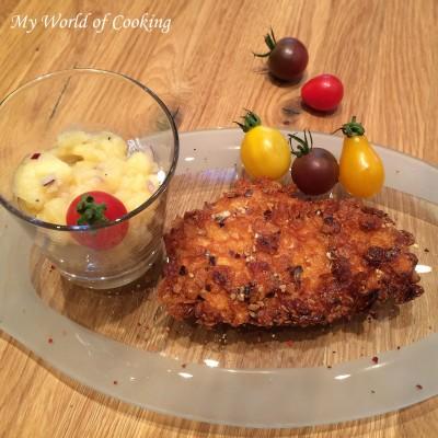 Hühnerschnitzerl in Cornflakes-Kürbiskern-Panier